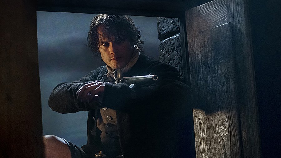 outlander-reckoning-jamie-at-window (1)